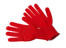 Working gloves. Pair of red textile working gloves isolated on white royalty free stock photography