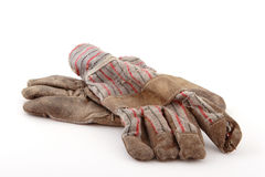 Working gloves. A pair of worn gloves stock photography