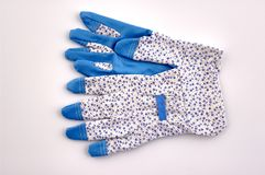 Working gloves. Pair of garden working gloves at white background royalty free stock images