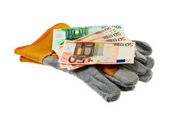 Working gloves and emolument. Isolated royalty free stock photo