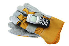 Working gloves and mobile phone Stock Photo