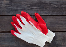 Working gloves ready on rustic wood Royalty Free Stock Image