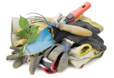 Working gloves and tools of farmer Stock Photos