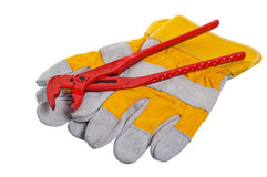 Working gloves and wrenches Stock Photography