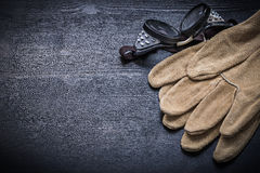 Working goggles and protective gloves Royalty Free Stock Image