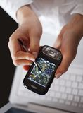 Working with gps. Working woman hands with laptop and phone with gps Royalty Free Stock Images