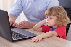 Working grandfather on laptop Stock Photo