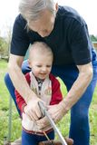 Working grandson royalty free stock image
