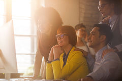 Working group on briefing in office. Young working group with manager on briefing in office Royalty Free Stock Images