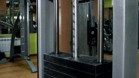 Working gym apparatus in the gymnasium. Working and moving gym stylish equipment in the gymnasium stock footage
