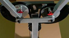 Working gym double circle detail equipment in the. Moving and working gym stylish double circle detail equipment in the gymnasium stock video footage