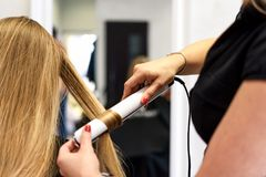 Working at the hairdresser salon stock photography