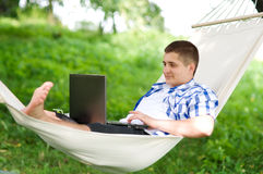 Working on hammock. With laptop Stock Photos