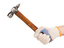 Working hand in glove holding a hammer Royalty Free Stock Photos