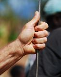 Working hand holding steel rod Royalty Free Stock Photos