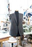 Working on a handmade jacket Stock Photos