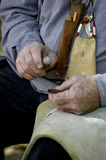 Working hands. Close-up detail of a man making flint arrowheads by hand Stock Photos