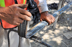 Working hands. Pic of a man working steel bars with his hands Royalty Free Stock Photo