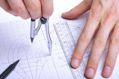 Working hands with calipers and rulers Stock Photo