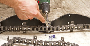 Working hands on Chain transporter Stock Image