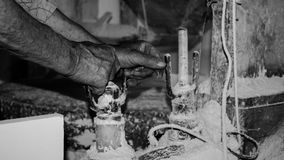 Working hands. A old man working in his water mill royalty free stock images