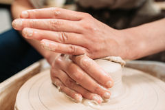 Working hands on potters wheel close-up Stock Photos