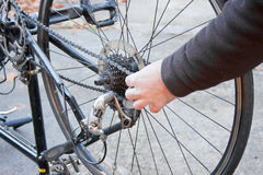 Working Hands Removing Bicycle Wheel Stock Images