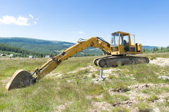 Working hard or hardly working. Excavator having a break from hard work Royalty Free Stock Photo