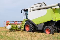 Working harvesting combine in field Royalty Free Stock Image