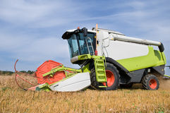 Working harvesting combine in field Stock Images