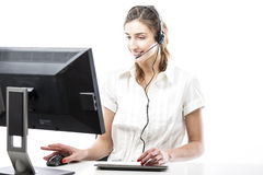 Working in headset in front of computer Stock Photography