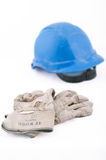 Working helmet and protectives. Blue working helmet and working protective gloves, isolated on white background Stock Photo