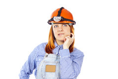 Working in a helmet thinking Stock Photo