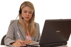 Working Help Desk. Business lady at computer with headset Royalty Free Stock Photography