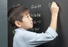 Working on his times tables. Stock Photos