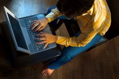 Working at Home. Young women is working on a laptop computer in home environment Stock Photo