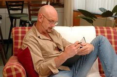 Working at home. A manager working overtime at home Royalty Free Stock Image