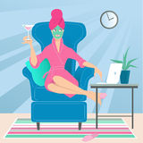 Working from home. Woman sitting in a comfortable chair at her home, in the middle of the day, in a robe, with a towel on her head, drinking cocktail, doing Stock Photos