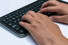 Working at home with laptop men writing a blog. Typing on a keyboard. Programmer or computer hacker royalty free stock photos