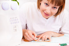 Working from home, a tailor at work. Royalty Free Stock Image