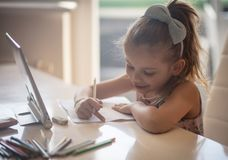 Working homework with a smile royalty free stock photography