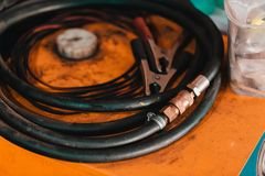 Working hoses in a garage. Stock Photo