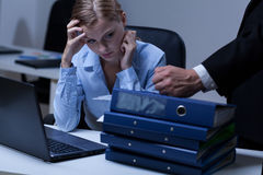 Working after hours. Young attractive secratary working after hours in company stock photography