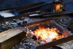 Working iron craftsman Royalty Free Stock Images