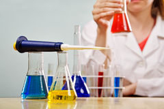 Working in a lab. Woman working with chemical lab equipmant Stock Images