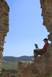 Working on a laptop. Image of a man working on a laptop outdoors Stock Images