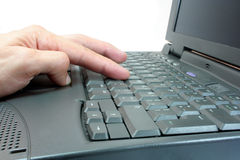 Working with a Laptop. Hands typing on computer keyboard Stock Photos