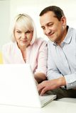 Working with laptop Royalty Free Stock Image