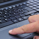 Working with a laptop. Closeup of the hand of someone who is working with a laptop royalty free stock images