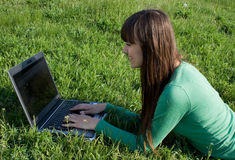 Working on laptop. Girl working on laptop outdoor Stock Images